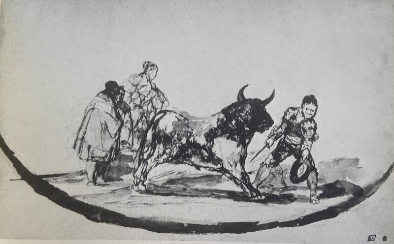 Matador citando a un toro con un sombrero