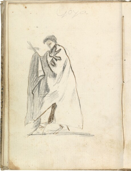 Figura masculina de perfil con manto, portando una cruz