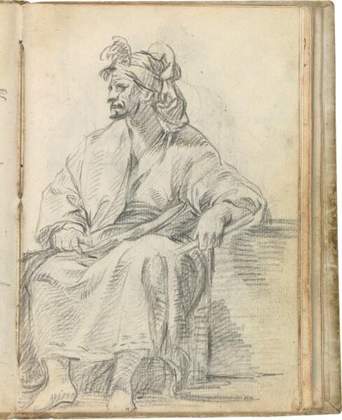 Figura masculina sentada, con un bastón en su mano izquierda y tocada con turbante