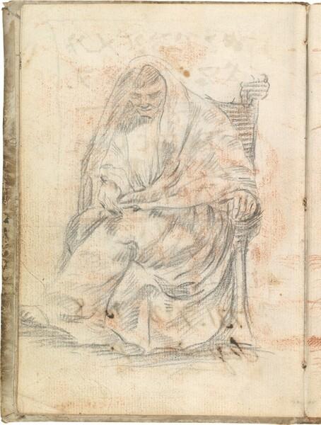 Figura togada sentada de frente