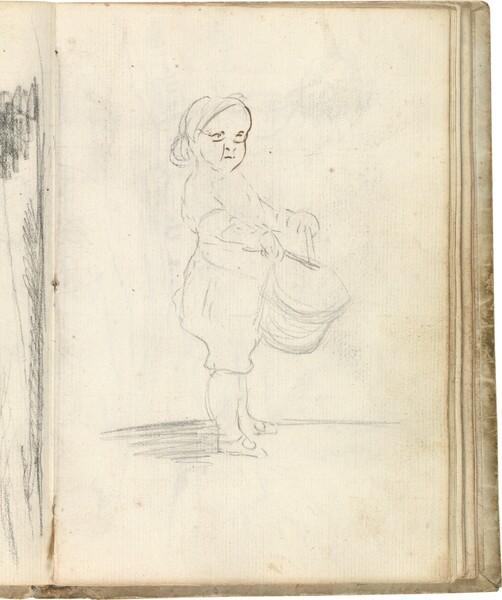 Niño de perfil tocando el tambor