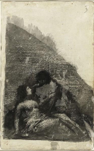 Pareja de enamorados sentados en una roca