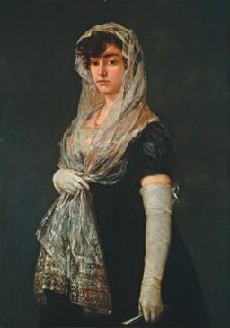 Mujer joven con mantilla y basquiña