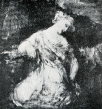 Mujer arrodillada en la oscuridad