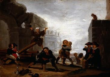 Niños jugando al balancín